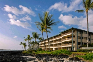 Kona Reef is a four-story oceanfront resort covering three acres of the gorgeous Kona coast. Every unit has a garden, partial ocean, or ocean view, with a patio or balcony. The ambience of the ocean is present while swimming in our pool that is perfect for family fun, with four barbecue grills and a party pavilion nearby. Take a ten minute walk to the historic fishing village of Kailua-Kona, and explore wonderful shops, sidewalk cafes, restaurants and art galleries.